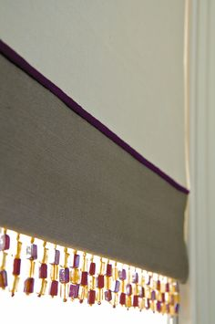 Prêt à Vivre | Design Ideas - roman blind with bottom border, piping and beading LIKE THE BEADING