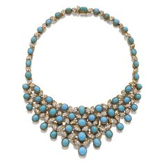 TURQUOISE AND DIAMOND NECKLACE, CARTIER, 1950S Of bib design, set with oval and round cabochon turquoise enhanced with stylised foliate motifs set with brilliant-cut diamonds, mounted in yellow gold