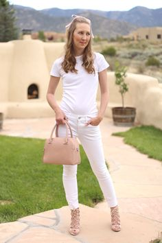 All White Outfit Ideas | white t-shirt, white skinny jeans, blush lace up heels, and a pink purse Cute Casual Summer Outfit | best fashion blogs  See more outfit ideas from A Modern Mom Blog here: www.amodernmomblog.com