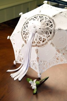 """Sign Me"" Bridal Shower Umbrella - A perfect special touch to any bridal shower. Each umbrella is adorned with 20 white satin ribbons, equaling 40 sides of ribbon for multiple guests to sign each ribbon strand and wish the bride and groom a special message."