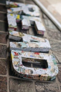 decoupage letters with old book pages or maps