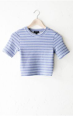 - Description - Size Guide Details: Short sleeve round neck striped crop top in blue/ivory. Form fitting, tend to run on the smaller side & are more fitted. Cropped. 49% Polyester, 41% Rayon, 2% Spand