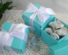 Adorable, authentic Looking Turquoise Blue Favor Boxes with Lids and Ribbon... Perfect for Theme Parties White Ribbon with Blue 2 Piece Boxes Custom Ribbon and Box Color Available Upon Request Multipurpose Boxes...perfect for Cookies, Candy, Favors Etc. 2 x 2 x 2 adorable Size with Box and Lid Separate Perfect for Birthdays, Weddings or any Party Celebration Custom Size Boxes Upon Request Gorgeous Boxes make an Elegant Presentation for Favors at showers, and receptions Easy Assemble B...
