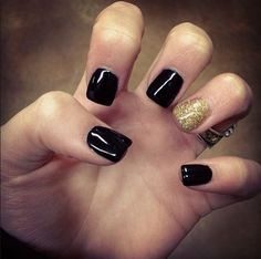 Gel nails. Black and gold