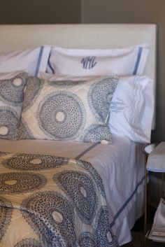 monogrammed pillows is a nice touch. (Matouk and John Robshaw Bedding)