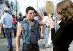 HOW WE CHOOSE TO THINK OF HIM  Eventually, Cruise's perfectionism became creepy. Let's ignore all that and focus instead on the young striver who wore double denim and a fake tat on the set of The Outsiders, giving us his best ruffian snarl.