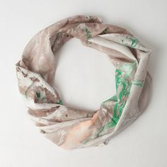 Beautiful silk scarf created by hand using water, wash safe paints, silk, and a very large fan.
