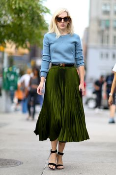 Olive green midi skirt with black heeled sandals and a blue high neck knitted jumper | Image via stylecaster.com