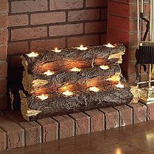 Great Fireplace Idea for any apartment, condo, or dorm!  Candle light wood logs - great thing to have!