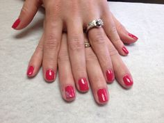 Hot pink with pale purple and sparkle pull through design on accent nails  Oasis Salon and Spa Mill Hall Pa (570)726-6565