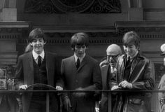 Paul McCartney, George Harrison, and John Lennon (look down on the masses of fans)