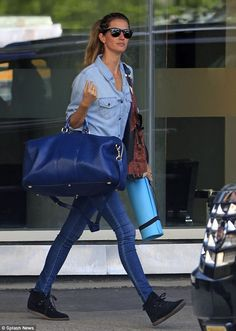 Precious cargo: Gisele Bundchen headed to yoga in New York on Wednesday carrying an overzised Gucci duffel for a gym bag
