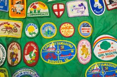 Girl Scout badges sewn onto a jacket - Beyond Retro Vintage Clothing Archive