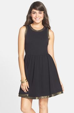 Free shipping and returns on Soprano Metallic Trim Skater Dress (Juniors) at Nordstrom.com. Take one stretch-woven sleeveless skater dress, trim it with glittering gold metallic and voilà: You're ready to party hop.