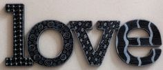 LOVE wall decor haning hand painted black and hand decorated with zentangle using white paint markers