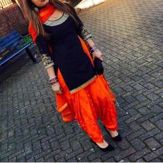 * Type- Patiyala Suit * Top Fabric- Cotton M.) * Top- Semi-Stitched * Color- Black * Bottom: Un-Stitched M) * Bottom Fabric: Cotton * Bottom Color: Orange * Work: Embroidered * Dupatta Fabric : Nazneen * Dupatta Color : Orange * Dupat Patiala Dress, Patiala Salwar Suits, Punjabi Dress, Churidar, Anarkali Dress, Dress Indian Style, Indian Wear, Indian Outfits, Indian Dresses