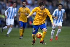 Lionel Messi of FC Barcelona controls the ball during the La Liga match between Malaga CF and FC Barcelona at La Rosaleda Stadium on January 23, 2016 in Malaga, Spain.