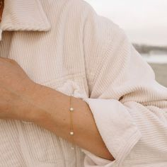 """Just like its matching necklace, this stunning Margot Pearl Bracelet is simple and elegant. The fresh-water pearls are suspended by a delicate and dainty 14K Gold Filled Chain. Dress it up or down, wear it alone or layered- it's up to you! - Fresh-water pearls & 14K Gold Filled Chain - Fits wrists 5.5"""" - 7"""" with an adjustable chain - Handcrafted with love from San Clemente, California The Fresh, Fresh Water, San Clemente, Water Pearls, Matching Necklaces, Pearl Bracelet, Delicate, California, Chain"""