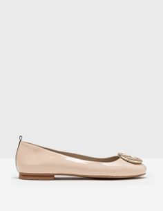 df50dfb0ac42 Shine on from morning to midnight in these polished patent leather flats.  Despite their bright