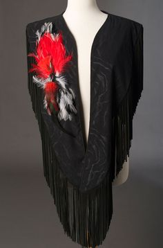 One of the latest creations by Ann N Eve is this beautiful one of a kind hand decorated Western long shawl.  The fabric used in this case looks like suede but it actually is made of fabric. It is a long dramatic shawl with fringes cascading down the shoulder. It has been hand decorated with feathers and beads in front and the back.
