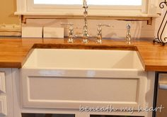 """Farmhouse sink in """"Beneath my heart's"""" kitchen (fireclay sink from Signature Hardware)"""