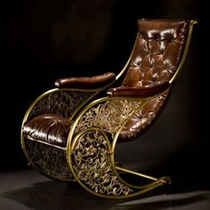 An 1850 Winfield rocking chair, gold lacquered tubular brass with cast and silvered foliate infill, newly upholstered in hand dyed and buttoned leather.
