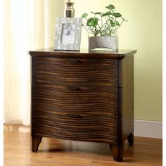 Make waves in the bedroom with this textured nightstand. The beautiful woodwork enhances the gentle curves of the drawer faces while spacious compartments provide ample room for your bedside necessities.