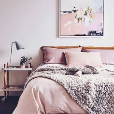 I'll take a nap here please. This dusty pink bedroom is an absolute dream. Love the huge throw.
