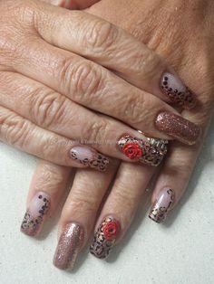 Gold gel polish, glitter and freehand leopard print nail art witn 3d acrylic flowers