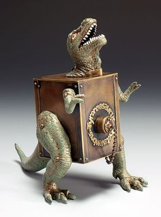 Pinhole camera Tyrannosaurus photoventris, ©2009, 6.75 inches high, Brass, plastic dinosaur, fabricated. Pinhole camera, uses paper film. by Judith Hoffman