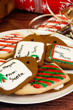 Take Christmas cookie decorating to the next level by turning them into labels for holiday gifts. Mix food color and vanilla extract to paint designs on frosted, gift tag-shaped gingerbread cookies. Then, thread a ribbon through the cookie, wrap it in a cellophane bag and attach to holiday gifts.