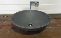- Dimensions: 410 (Diameter) x 125 (H) - Weight: approx. 5kg - Without Overflow - Plug, Waste, & Tapware not included - Measurements are approximate as each basin is handmade - Please allow 3-4 weeks for production - Available in Natural White, Medium Grey, & Charcoal (as shown) - Note actual colours may vary slightly
