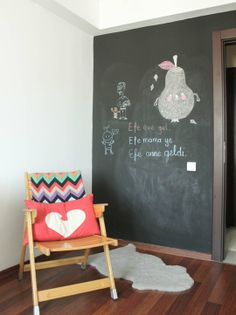 Efe's Scandinavian-Inspired Space. Paint a wall in chalk board paint.
