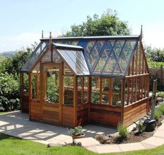 Incredible stained wood greenhouse