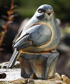 Add a fun feathered friend to a garden or porch with this statue. The intricate details and charming design will look fantastic when surrounded by the changing leaves that fall brings. Bird Statues, Tree Carving, Wood Carving Patterns, Wooden Bird, Bird Sculpture, Wood Creations, Driftwood Art, Tree Art, Bird Art