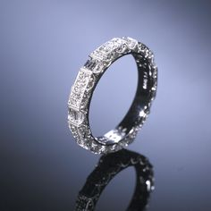 Google Image Result for http://www.adamasfinejewelry.com/SI-Sites/AdamasFineJewelry/ClientFiles/Images/products/weddingcollection/lg_wb16L.jpg