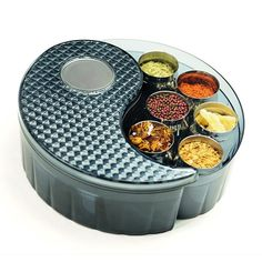 The #GitaDini #Yin Yang #Storage Bins are a twist on the traditional #masala #dabba the spice bin fixture of every Indian kitchen. They provide elegant, airtight storage for up to 12 different spices, herbs, seeds, nuts, etc.