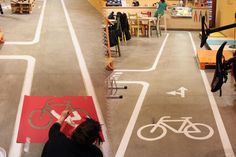 Decoration on the floor of asphalt bike path in a bicycle caffè. store #atelierovunque #ovunque #decoration #floor #interior #design #bicycle #catania #handmade #stencil #acrilyc