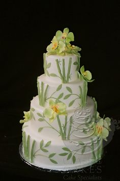 Sugar bamboo and orchids...clean and elegant! This is a beautiful cake