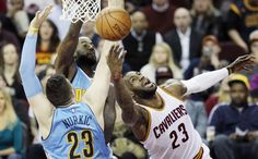 Victor Oladipo (5) loses the ball between the defense of Cleveland Cavaliers forward Kevin Love (0) and guard Kyrie Irving (2)