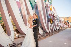 "How cool is this ""In Love"" sign at the Neon Boneyard in Las Vegas?! It's the perfect place to capture wedding photos."