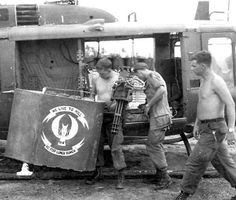Unit Name: 114th Aviation Compay Vihnlong  Getting ready for a flare dropping mission, Knights of the Air slick had a special device on the side of the chopper, to carry multiple flares. Note logo on the flare pod. Door gunner had free mini, geared back to about 2500 rounds a minute.