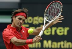 Roger Federer of Switzerland returns to Juan Martin del Potro of Argentina at the All England Lawn Tennis Club in Wimbledon, London at the 2012 Summer Olympics, Friday, Aug. 3, 2012. (AP Photo/Elise Amendola)