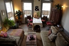 Always looking for apartment makeovers.  I love the coziness of this room.  It'd make a great hangout.  Picturing lots of candles at night :)