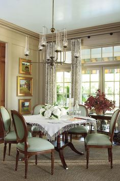 Dining Room - Senoia Georgia Idea House Tour - Southernliving. On the left side of the room, reclaimed heart-pine pocket doors can be closed to give privacy from the kitchen.