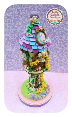 https://flic.kr/p/fKwC2a | Keepsake Tangled Tower cake topper | handcrafted keepsake cake topper for birthdays and baby showers  customizable  created from polymer clay, wood, glitter, acrylic paint, love  www.jellycakesdesigns.etsy.com www.facebook.com/jellylanedesigns