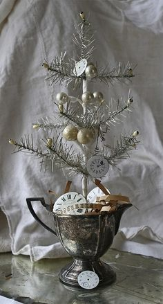 I like the idea of the silver creamer for a feather tree. A family silver piece would make a wonderful keepsake tree.