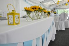 Yellow lantern and sunflowers or daisies; light blue pennant banner