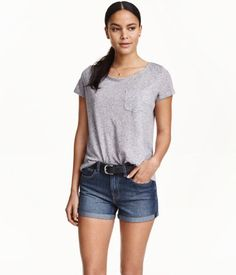 $7 H&M  Short-sleeved top in jersey with chest pocket.