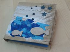 Âlbum realitzat amb cartro reciclat, gesso, paper de seda i plàstic màgic